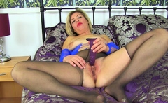 UK mature Emma loves playing in tights with a dildo